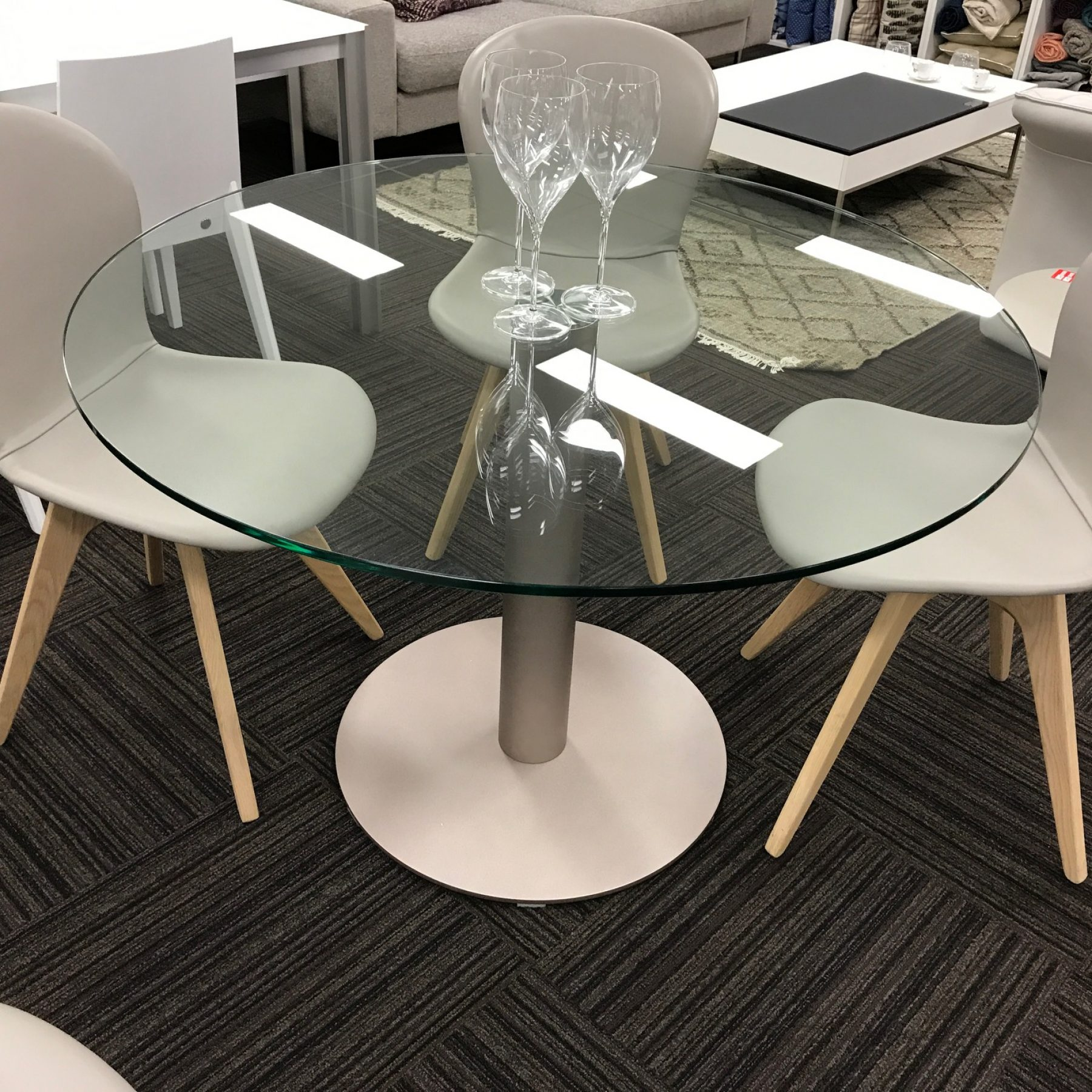 Warehouse Clearance Hudson 1100 Round Dining Table Clear Glass With Champagne